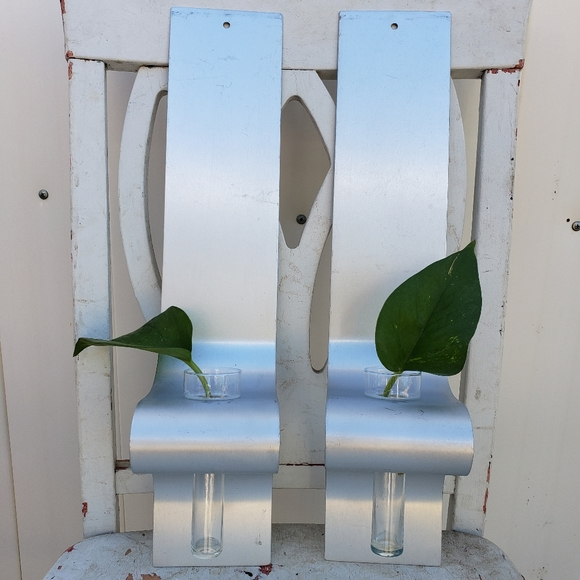 Metal wall sconces with glass vases